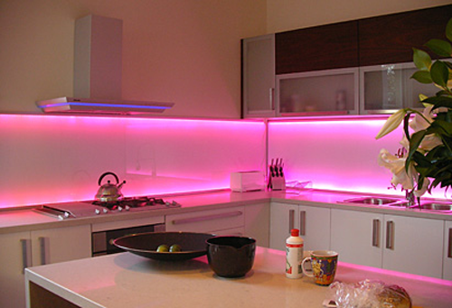 Glass splashback encased over pink fluroscent lights