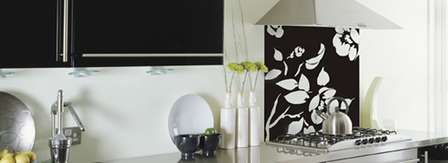 Designs of black and white floral mural behind glass splashback